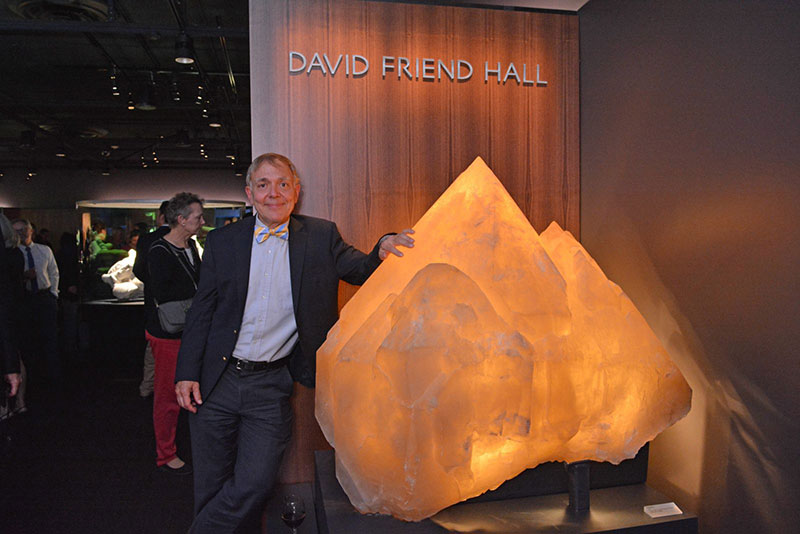 David Friend stands beside the 2,000-pound quartz crystal from Namibia that greets visitors to David Friend Hall. The photo was taken during a ribbon-cutting ceremony held on Oct. 13, 2016. (Photo: Michael Marsland, courtesy of Yale University)