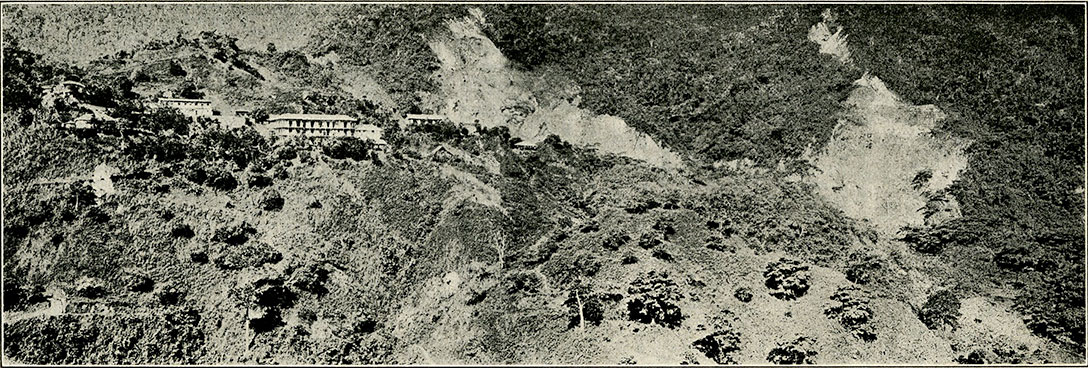 Fig. 3.—View of mine buildings and largest open cuts at the Muzo mines.