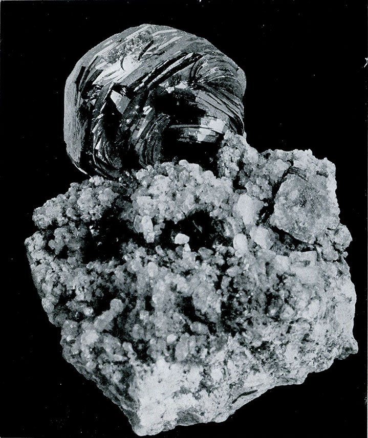 """Hematite from St. Gothard, Switzerland.  A rosette of flat crystals or """"iron rose."""""""