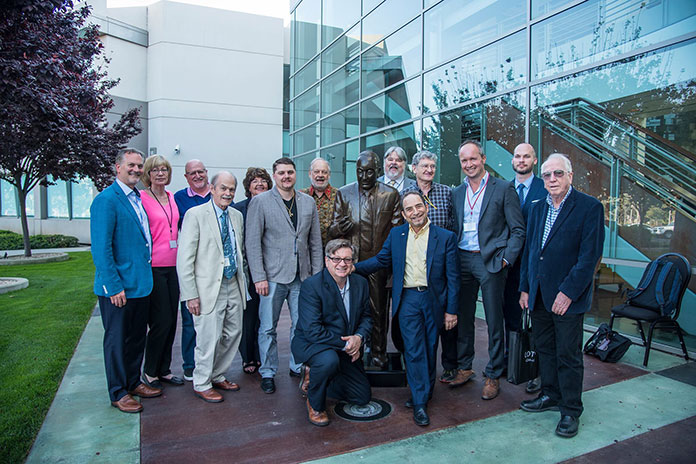 "Symposium presenters, gathered around the statue of Richard Liddicoat, for whom GIA's library is named, from left: Edward Boehm, Lisbet Thoresen, Richard W. Hughes, Dr. George Harlow, Dona Dirlam (GIA library director), Carl Larson, Dr. William ""Skip"" Simmons, Robert Weldon (kneeling), Shane McClure, Glenn Lehrer, Dr. George Rossman, Alan Hart, Nathan Renfro, and Dr. John Emmett.  Click  to enlarge. (Photo: Gloria Staebler)"