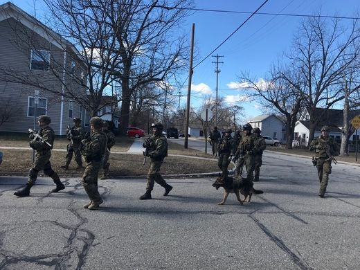 Coming soon to your neighborhood. Law enforcement on the streets of Mt Pleasant. Photo by Sarah Lehr, Lansing State Journal