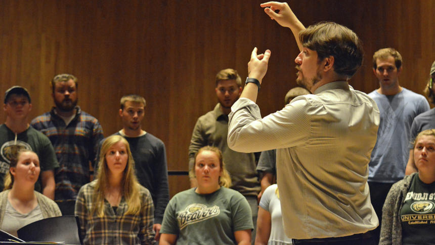 BSU Assistant Professor of Music Dwight Jilek conducts the BSU choir during a recent rehearsal ahead of the choir's reunion concert Saturday night. (Jordan Shearer | Bemidji Pioneer)