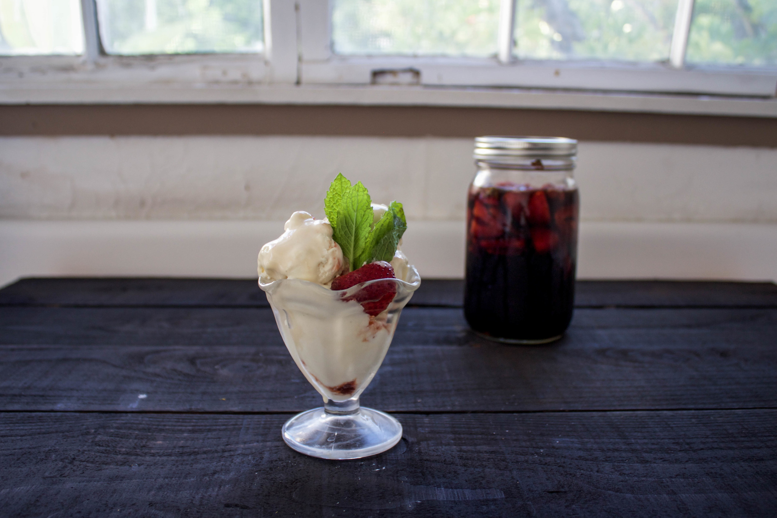 Assemble by putting a few pickled strawberries on a scoop of ice cream, add a sprig of mint.  What might be interesting would be taking some of the brining liquor and concentrating it into a syrup by boiling it down.
