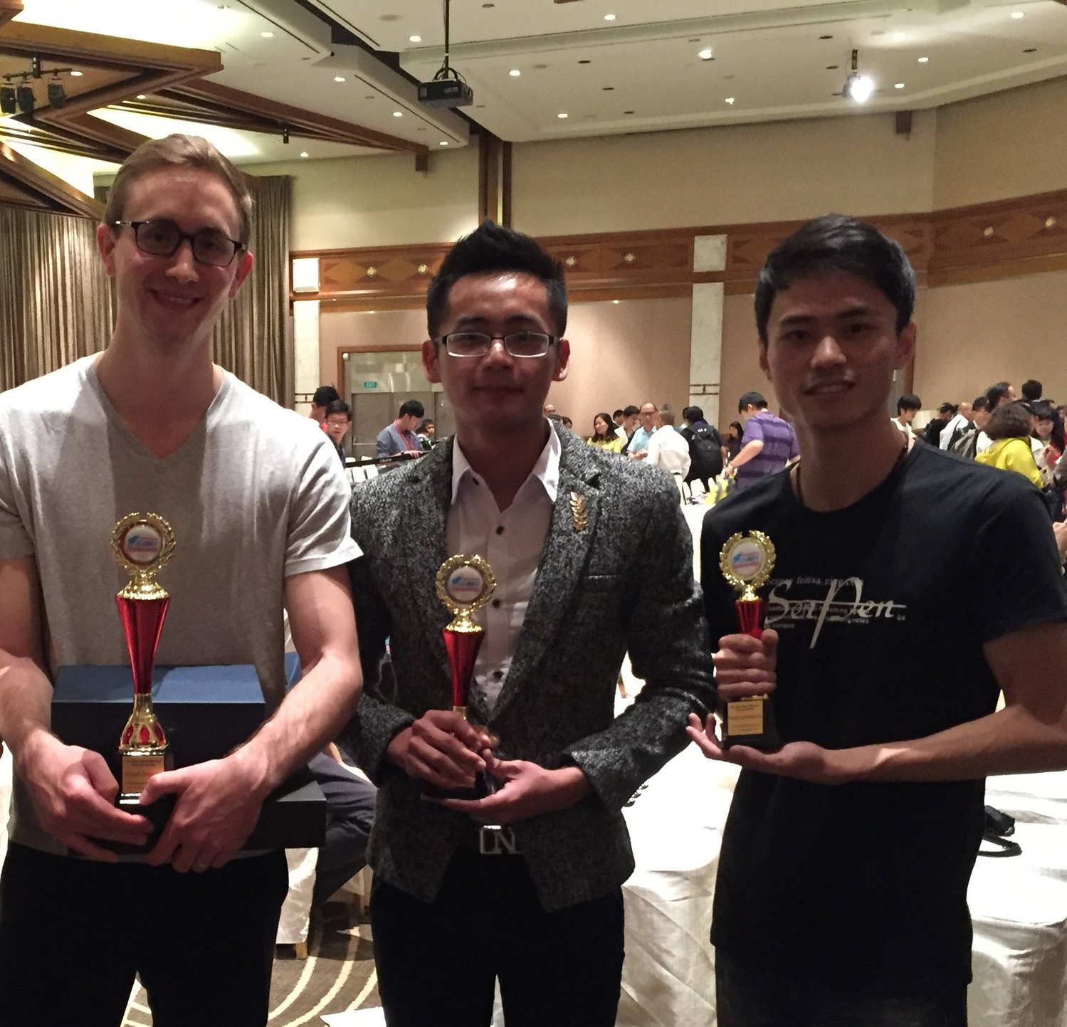 At the 2016 World Memory Championship in Singapore. Left to right: me, Huang Shenghua, and Su Zehe.