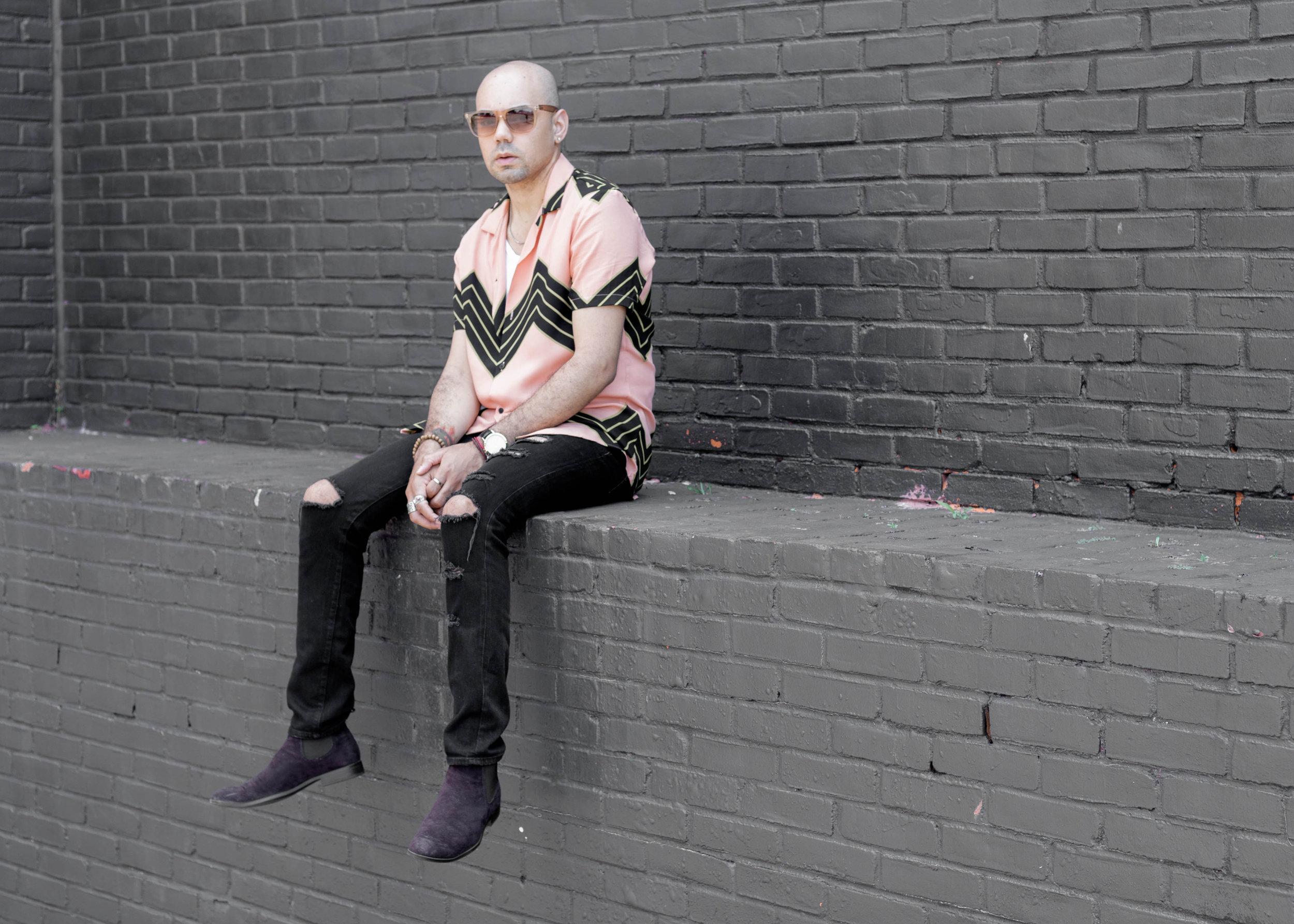 zig-zag-woven-distressed-denim-jeans-seated-2.jpg