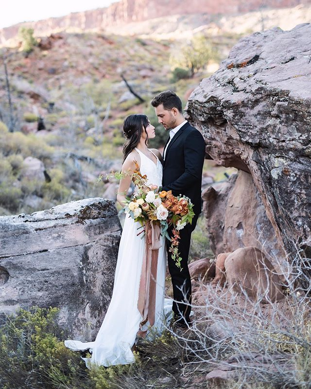 Portland can't seem to make up its mind. Still not sure if it's spring or winter. Either way in honor of #tbt I'll close my eyes and imagine myself in sunny Utah again!  Taken at the Zion #TylerRyeWorkshop Workshop @tylerrye_ Gown @jannmariebridal  Florals @bybloomers Muah @thomastimes Silks @Froufrouchic Suit @Zara Rings @susiesaltzman Models @tngmodels @ziagoddess@aaron.m.owen  Workshop Assistants @maccoydean & @nikirhodesphoto Sponsors @fujifilm_profilm@photovisionprints