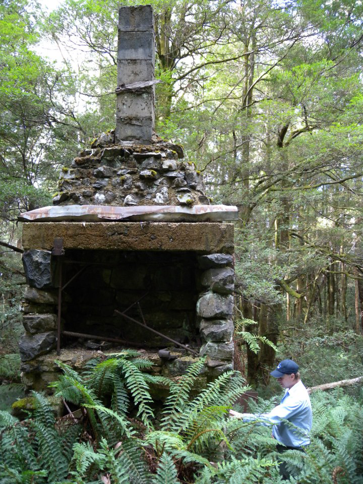 The author at University Ski Club chimney in March 2013 after a four hour search for it. The chimney is all that remains today after the cabin was shifted to Mt Buller in 1950. Photo © Blair Hamilton.