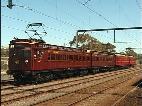 A 2002 recreation of an E-Train of the type that ran to Warburton in the 1930s. The 'Swing Door' (also known as 'Dog Box' ) electric cars at the front towed the country carriages at the back to the suburban terminus at Lilydale, where a steam engine took over for the second half of the journey. Photo © James Brook. Used with permission.  Video of the recreated trip .