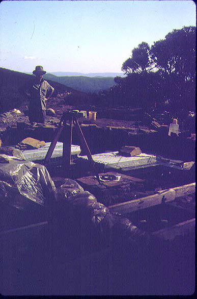 A poor photo – under the plastic sheet on the left are the floorboards and the aluminium frame members are stacked behind the theodolite tripod.