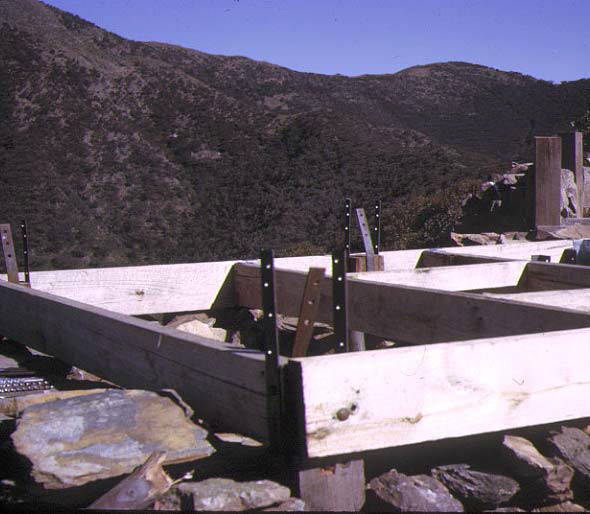 Front entrance – the straps were used to attach to the frame members so that the weight of the rock walls could be used to resist wind loads.