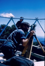 Peter Kneen with the theodolite. This was borrowed from the Civil Engineering school (Uni of Melbourne). It was sealed up and hidden in the bushes after a weekend's work.