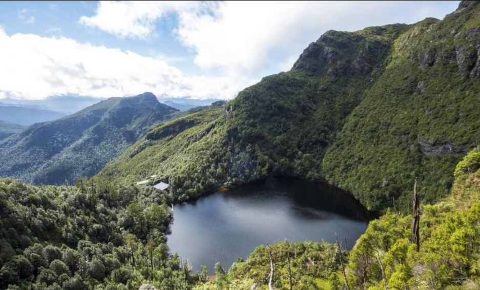 Third Lake Tahune Hut from the base of Frenchmans Cap cliffs. From  Green Design  site