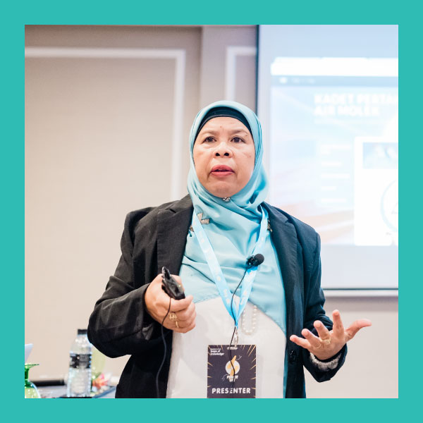 Norsiah Abd Rahman (GRAND PRIZE WINNER)      Headmistress, SMK Air Molek, Melaka    Puan Norsiah was first introduced to the Frog VLE in 2011 while teaching in SMK Tun Tuah. From then on, she set off on a journey towards 21st century teaching and learning with Frog. In 2014, she started a Frog Hub in SMK Bukit Katil as the Headmistress of the school then. She began actively training teachers on how to use and optimize Frog in teaching and learning. Through her constant encouragement and engagement with teachers, SMK Bukit Katil became one of the top schools in the state with the highest Frog usage rate. In 2016, she was transferred to SMK Air Molek to be the Headmistress of the school where she brought various changes to the school through the use and implementation of Frog.