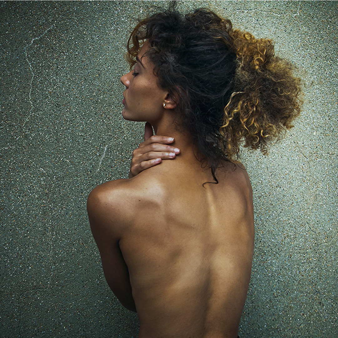 Exibit A:  An image of a woman's upper back.