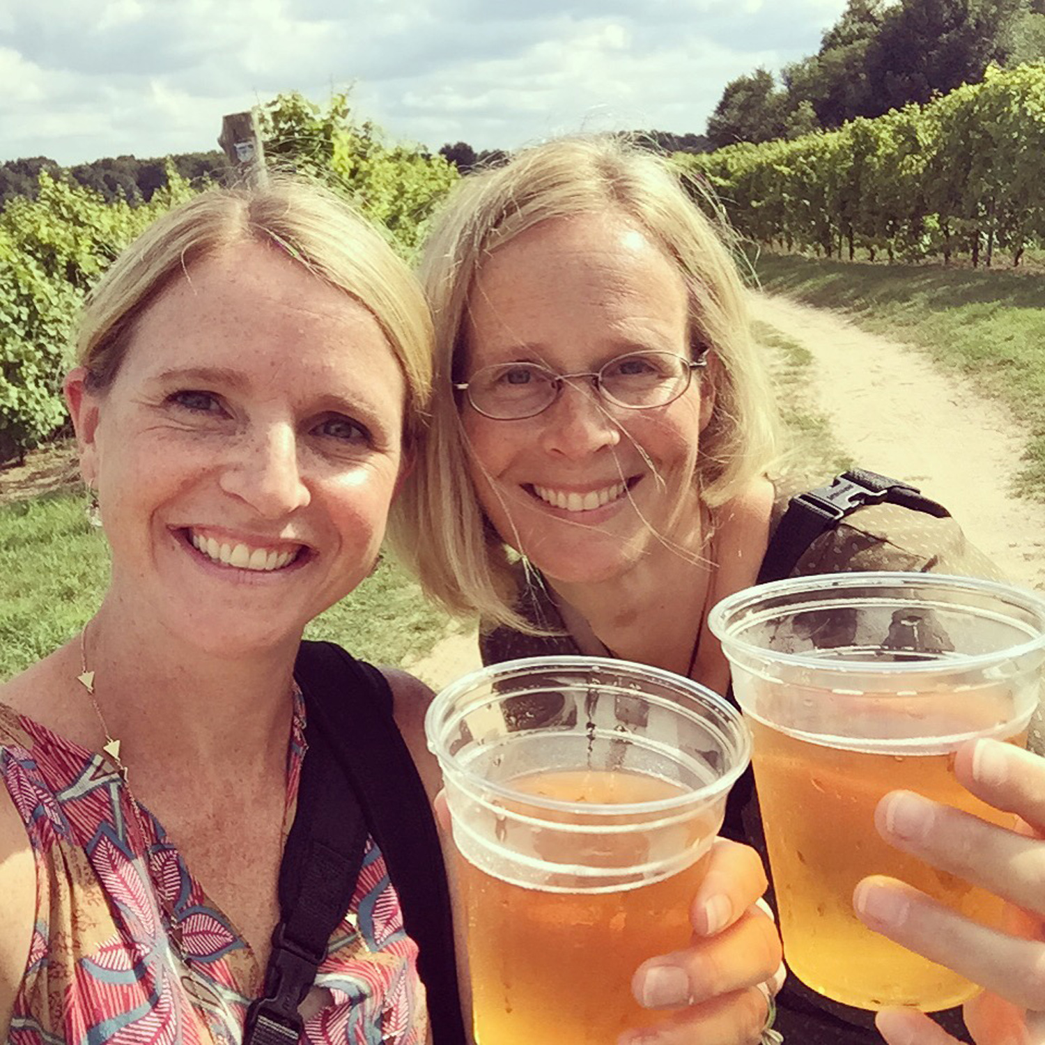 being offered cider while shooting a vineyard wedding - what a perk!