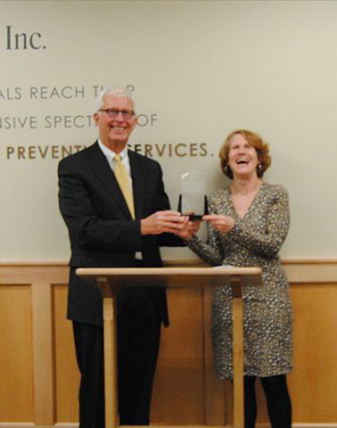 Lisa Davis, PORH Director present the award to Jack Goga, DCI CEO