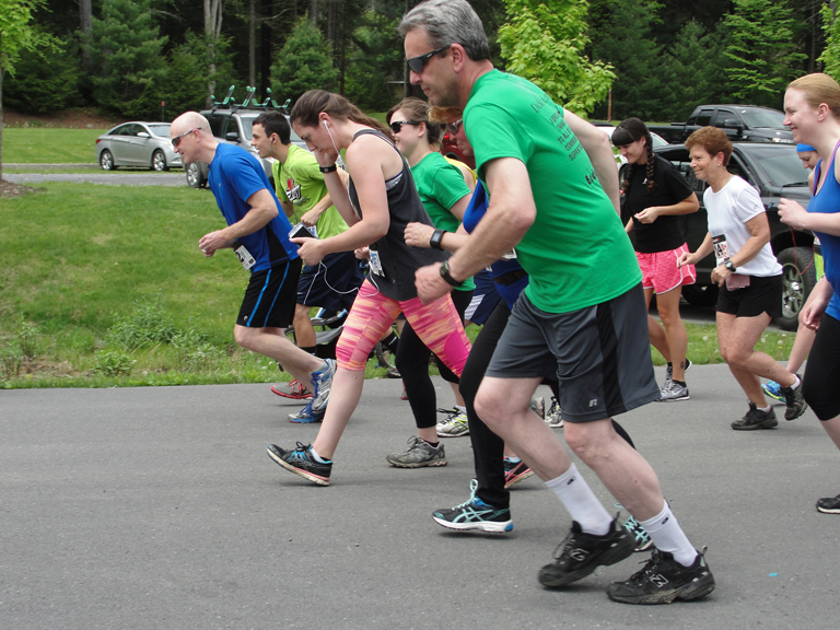 Runners and walkers cross the starting line at the 1st Annual Run/Walk for Wellness 5k held at Sinnemahoning State Park on May 17, 2015.