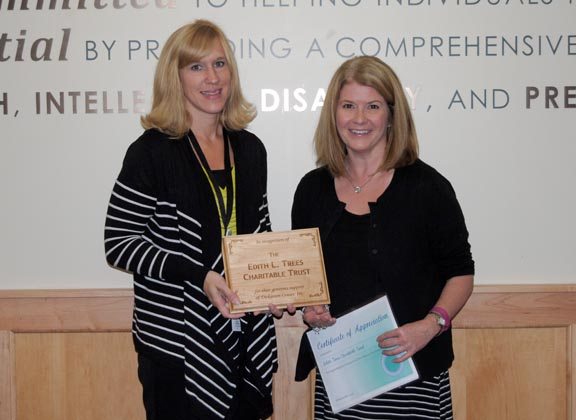 Pictured L-R: Heidi Thomas, DCI Interim CEO presents a plaque and certificate of appreciation to Amanda Creps, Trustee from the Edith Trees Charitable Trust