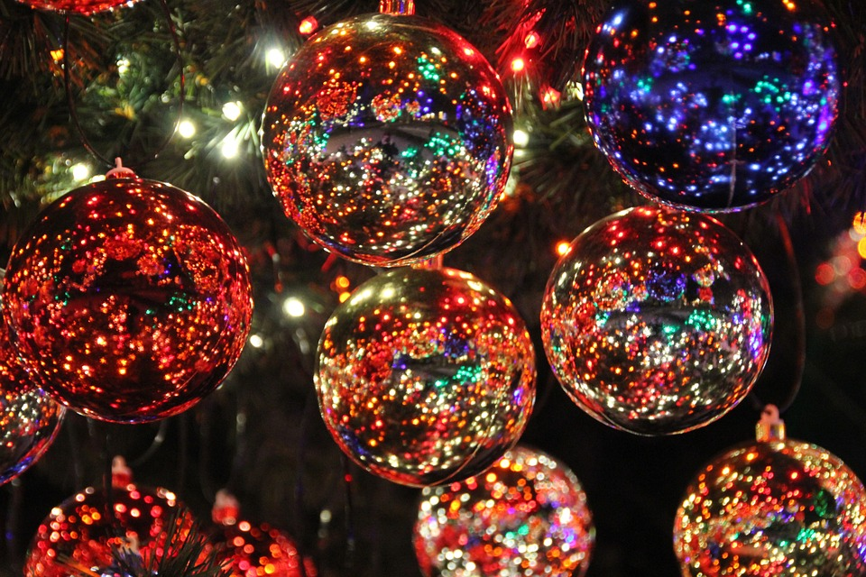 Photo of Christmas bulbs and lights on a tree