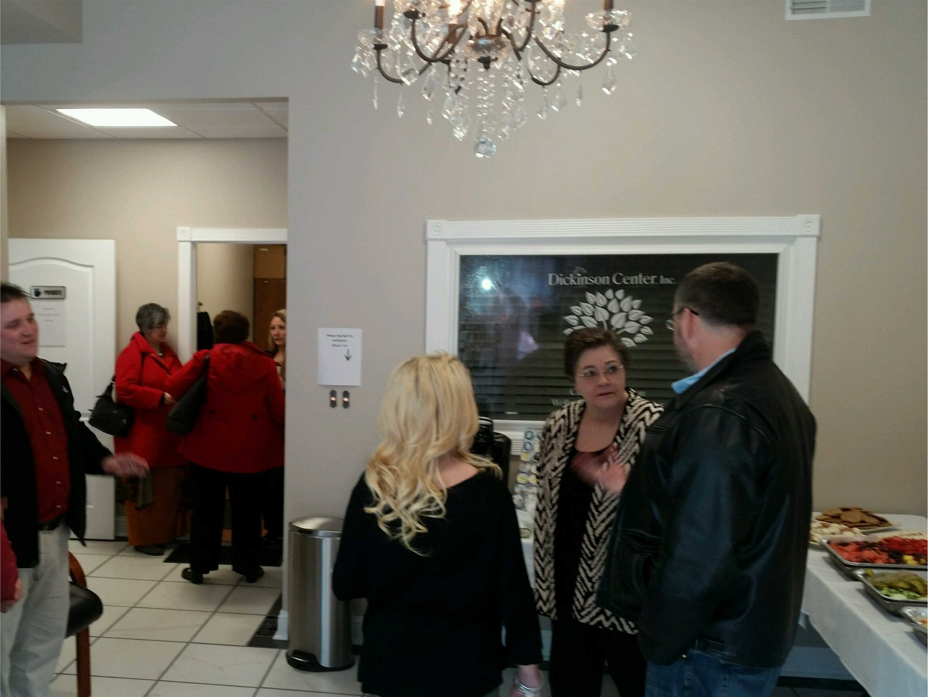 Photo of people mingling at the open house