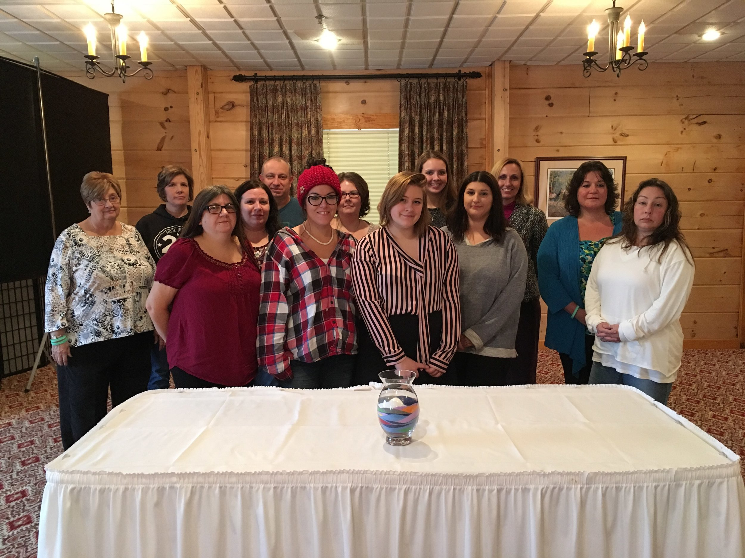 Elk County Survivors of Suicide Event - On Saturday, November 17th, thousands of people gathered to attend events around the world, coming together with other survivors of suicide loss to share stories and gain understanding and hope in their healing journey. Pictured above are the attendees of the Elk County Survivors of Suicide Loss event hosted by Dickinson Center, Inc. at the Red Fern. The event closed with a sand ceremony during which attendees chose sand colors representing the nature of their loss/reason for attending.