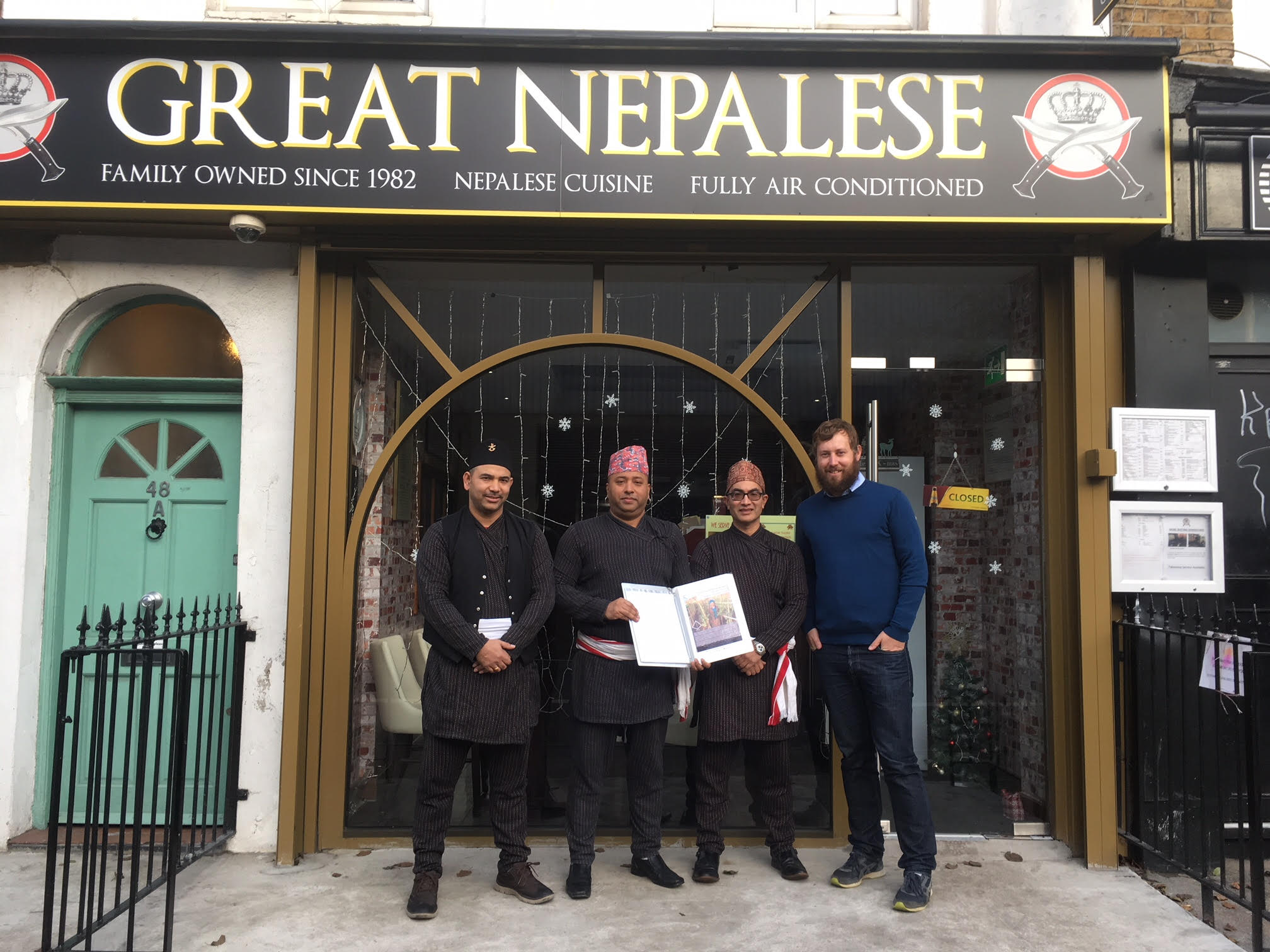 From left to right: Kiran, Baz and Jitendra Manandhar with TGT Co-Director Morgan Phillips at The Great Nepalese Restaurant.