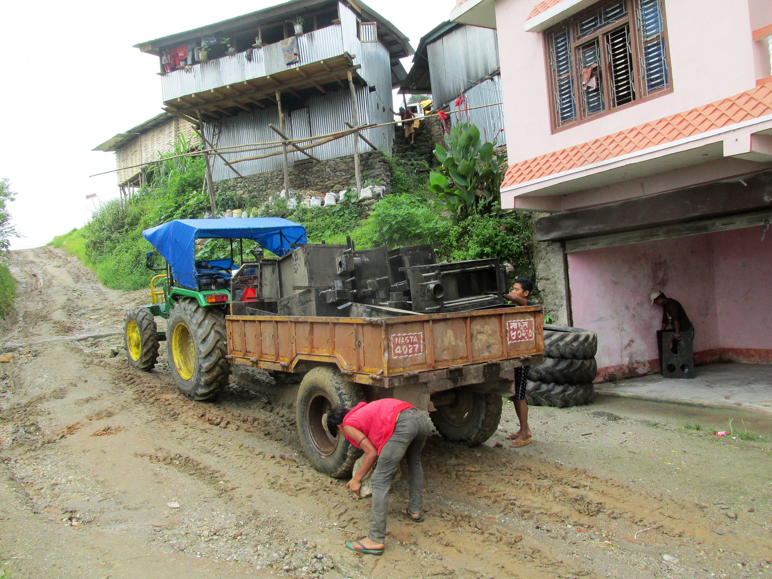 After Khandbari, the road becomes a dirt track, so the stoves were transferred to a tractor and trailer for the next leg of the journey.