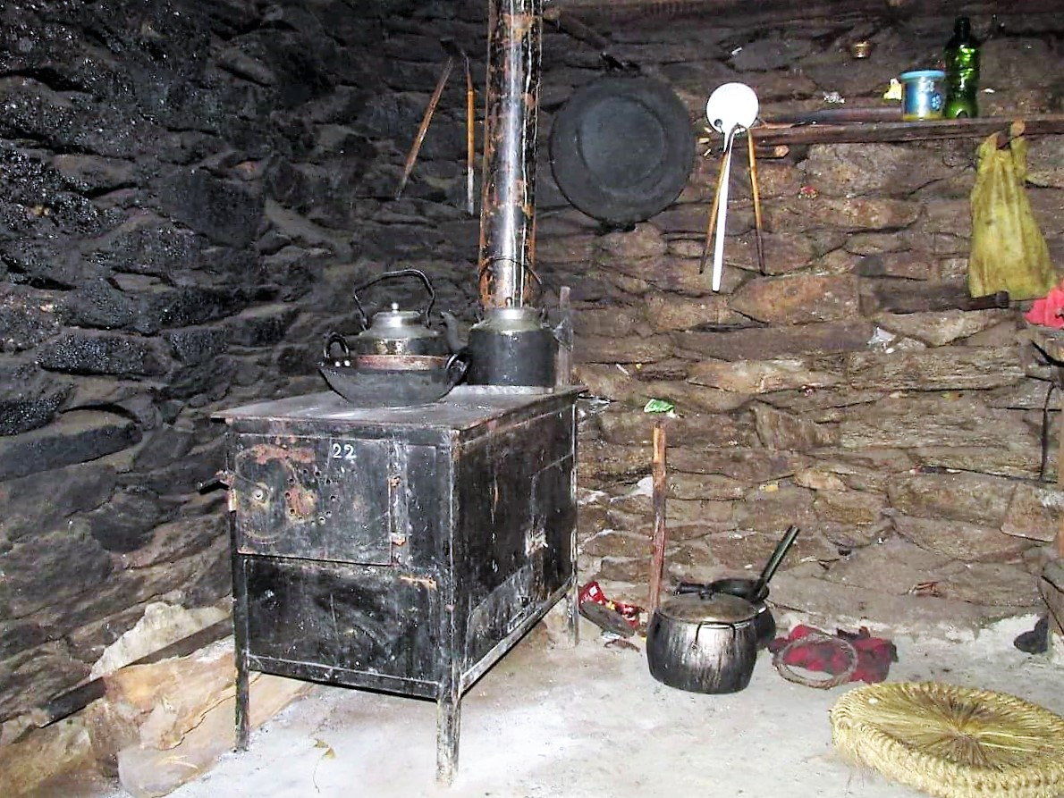 A stove finally installed in a home in Chepuwa. Note the blackened wall behind the stove, this is a result of the soot from the open fire that has burned here for generations before, with the introduction of these stoves, black walls will become a thing of the past.