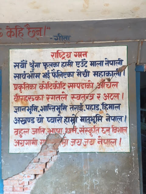 The earthquake caused a lot of damage in Kavre, here we can see a crack in the wall of the school, straight through the Nepali national anthem. (November 2017)