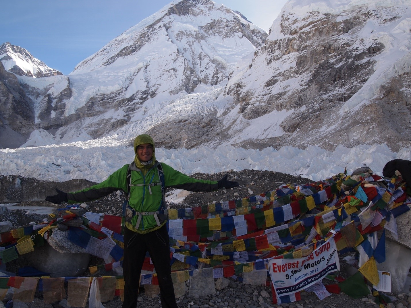 Figure 1.  David Rounce taking a quick break from his fieldwork in 2014 to visit Everest Base Camp in the Nepal Himalaya.