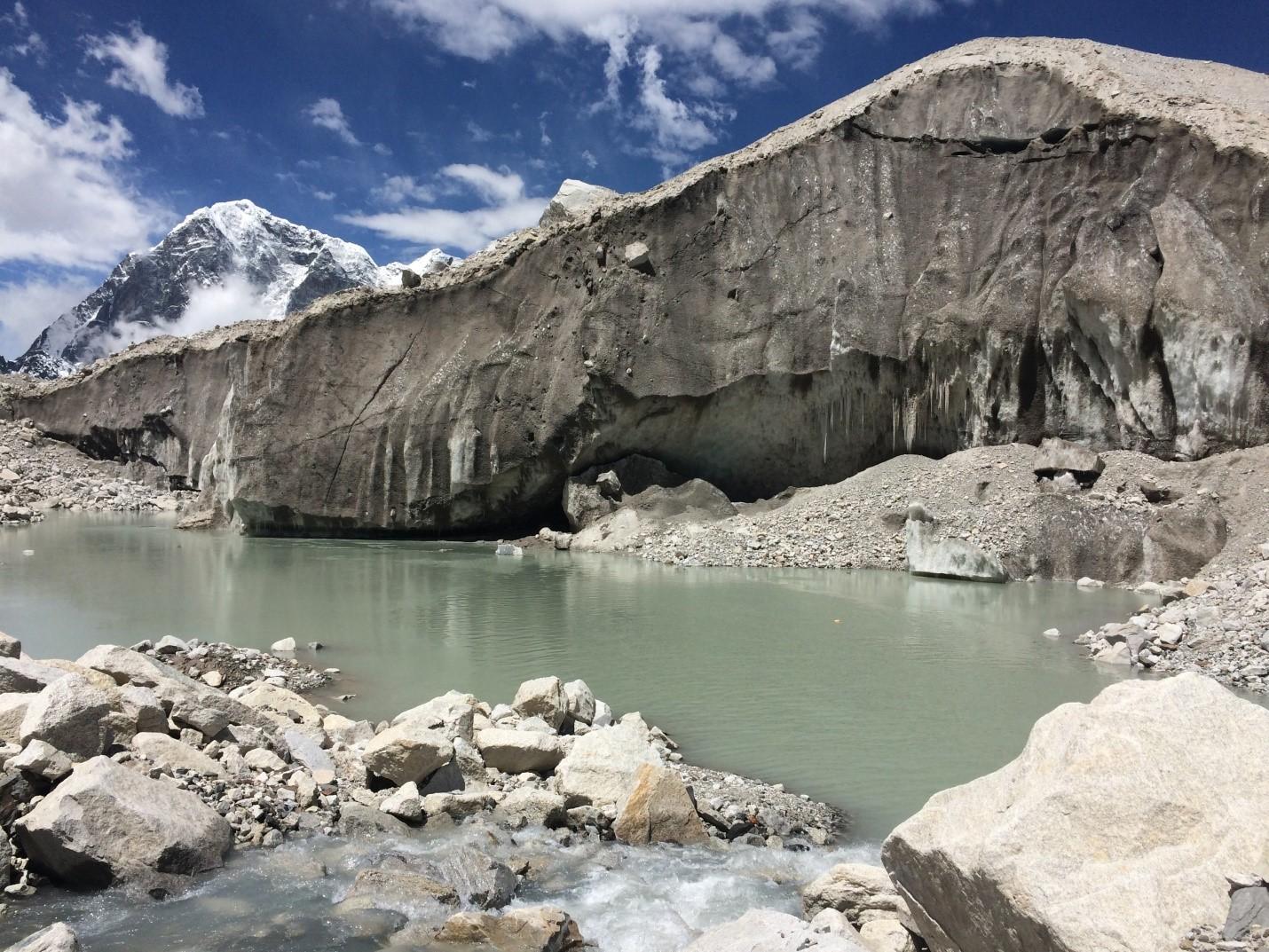 Figure 3 . Supraglacial pond and ice cliff on Khumbu Glacier (credit: Owen King).