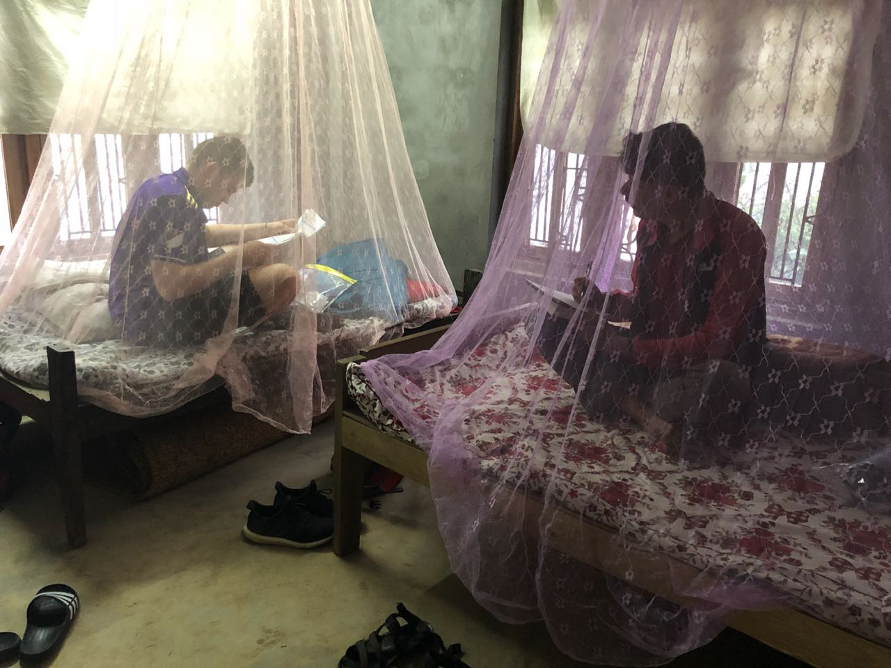 Tom and Amrit get down to work beneath their Mosquito nets.
