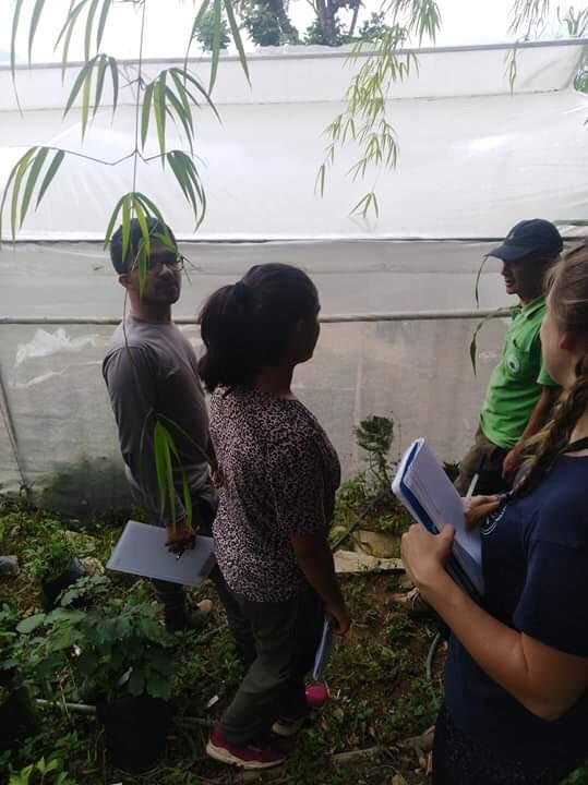 Navin Bhangade, Kanchan Kattel and Rachel Roberts learn about the installation of polytunnels at Deusa AFRC.