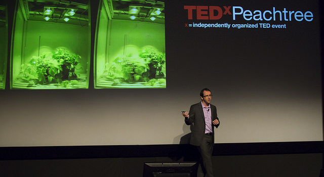 Eric Mattos illustrates LED illumination systems for photosynthesis applications.  Photo credit: TEDxPeachtree Team Flickr