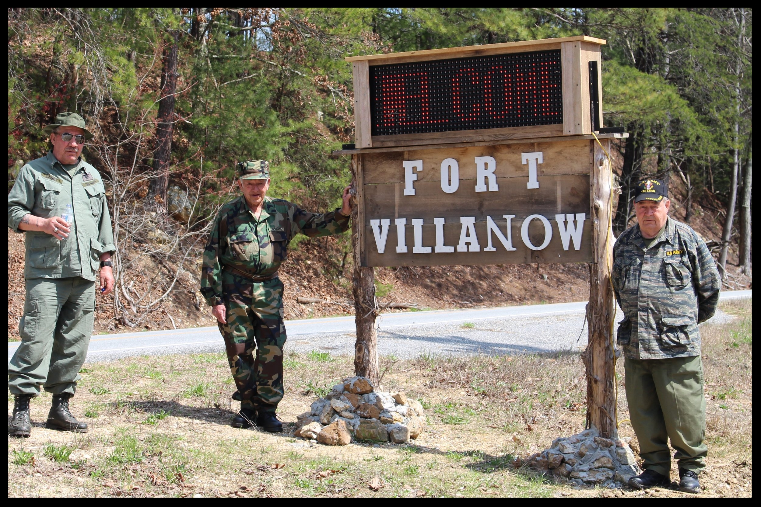 Veterans at Welcome Sign.JPG