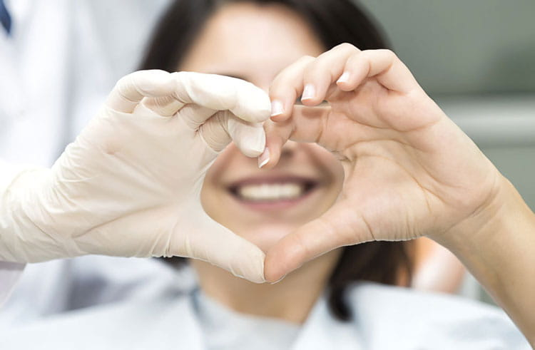 woman-making-heart-shape-with-hands.jpg