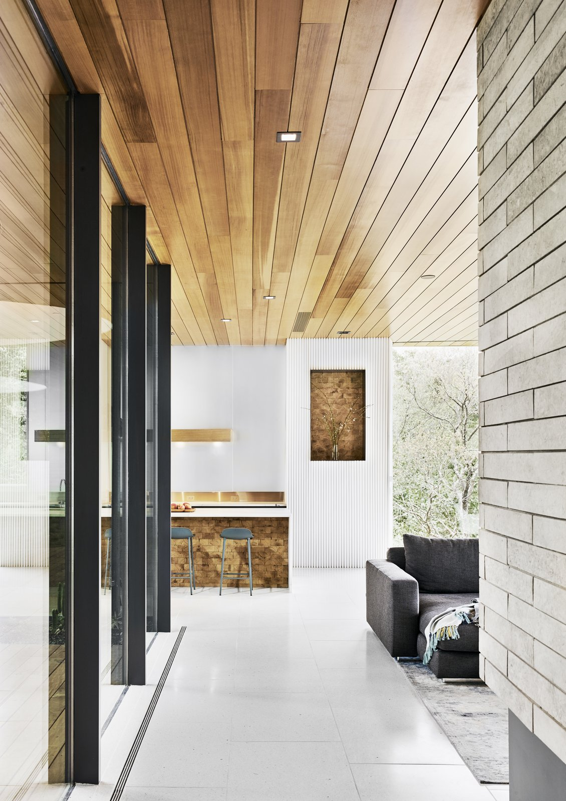 both-the-niche-and-the-base-of-the-kitchen-island-are-covered-in-reclaimed-end-grain-red-oak.jpg