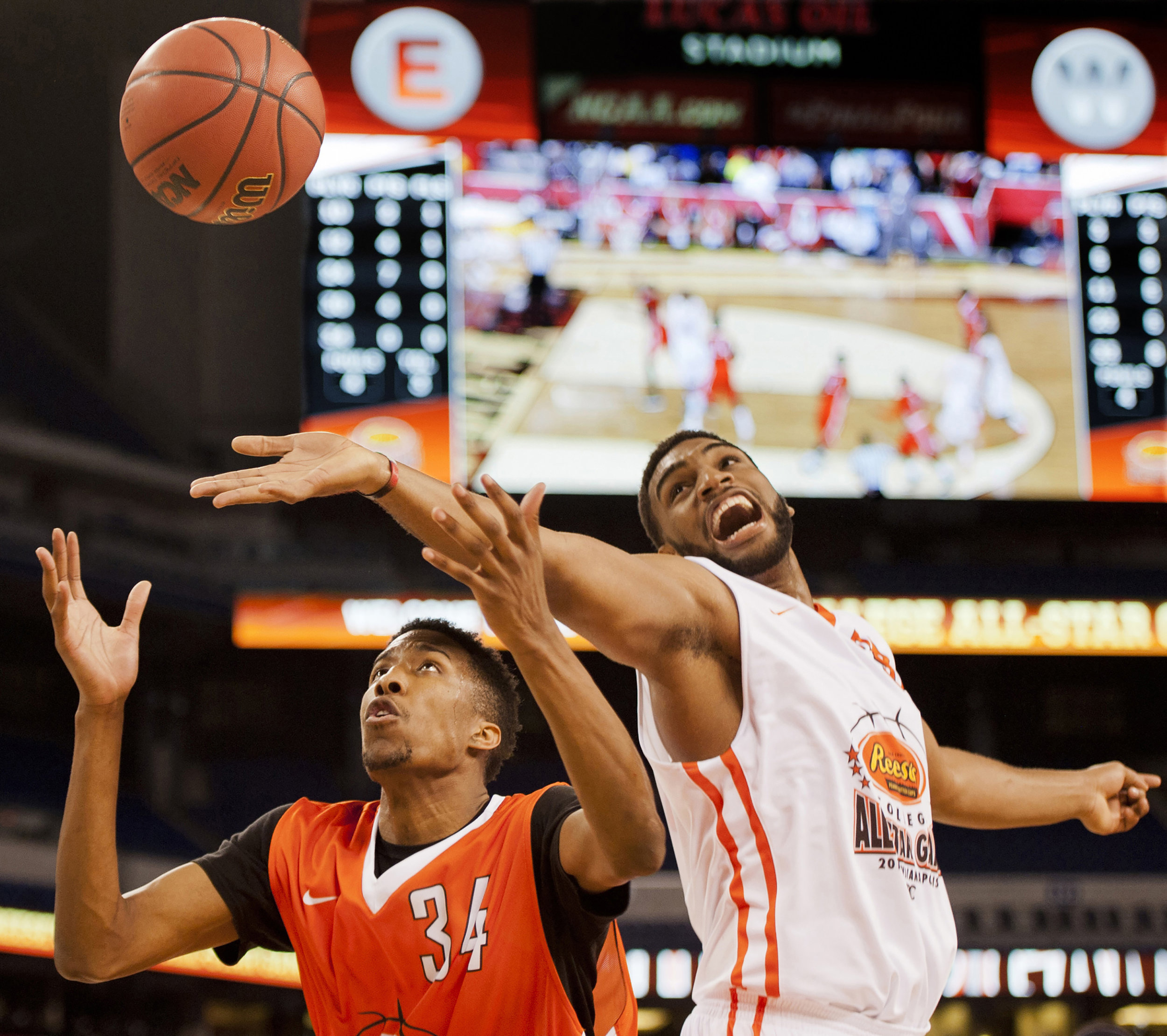 Alan Williams, a center from the University of California, Santa Barbara, tries to get a rebound over Kameron Woods, a forward from Butler University, at the Reese's College All-Star Game on April 3, 2015, at Lucas Oil Stadium. Woods led his team with 14 rebounds in the competition.