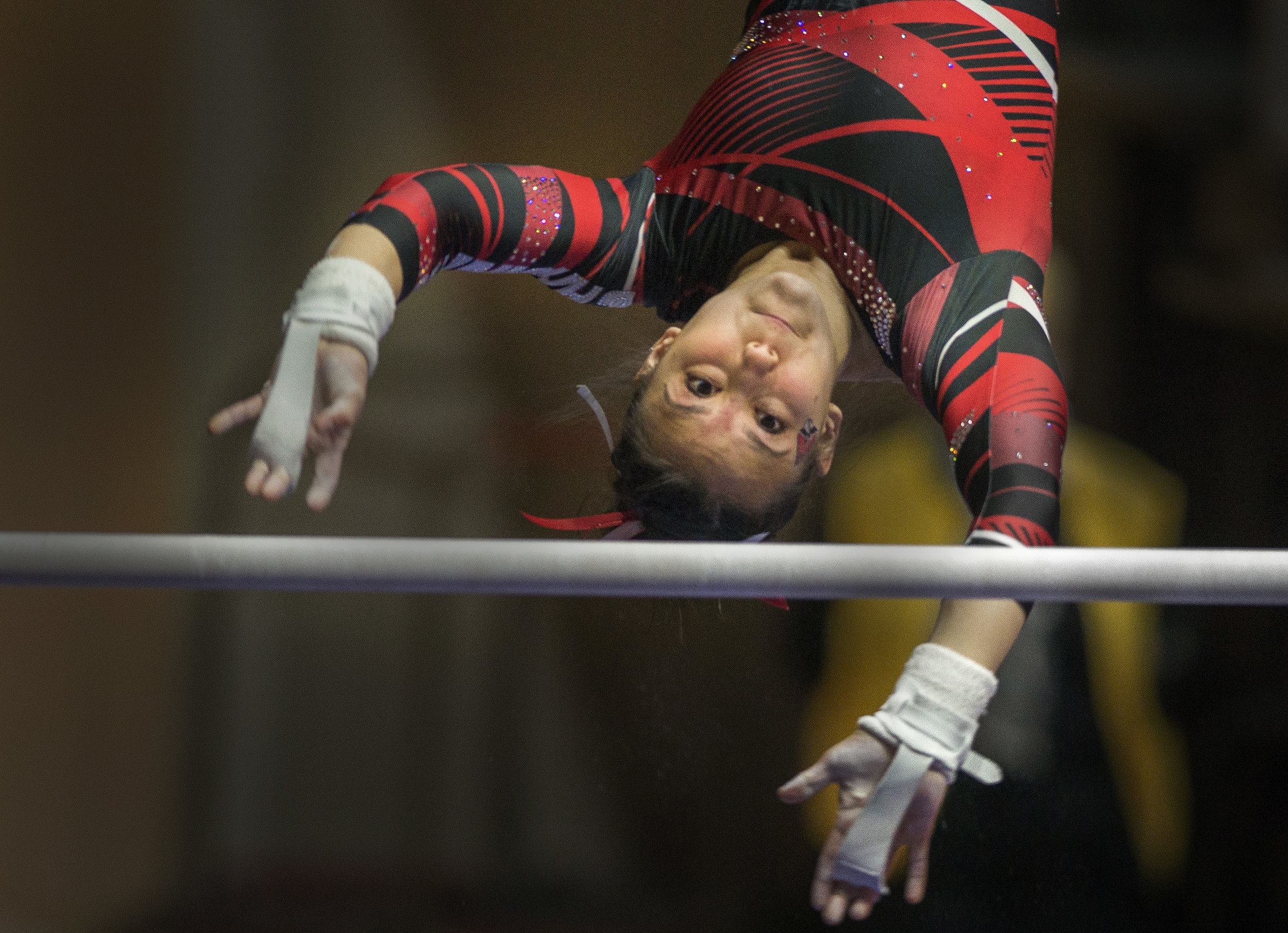 Sophomore Sydney Finke performs her routine on the uneven bars during the meet against Northern Illinois on Jan. 15, 2017, at Worthen Arena.
