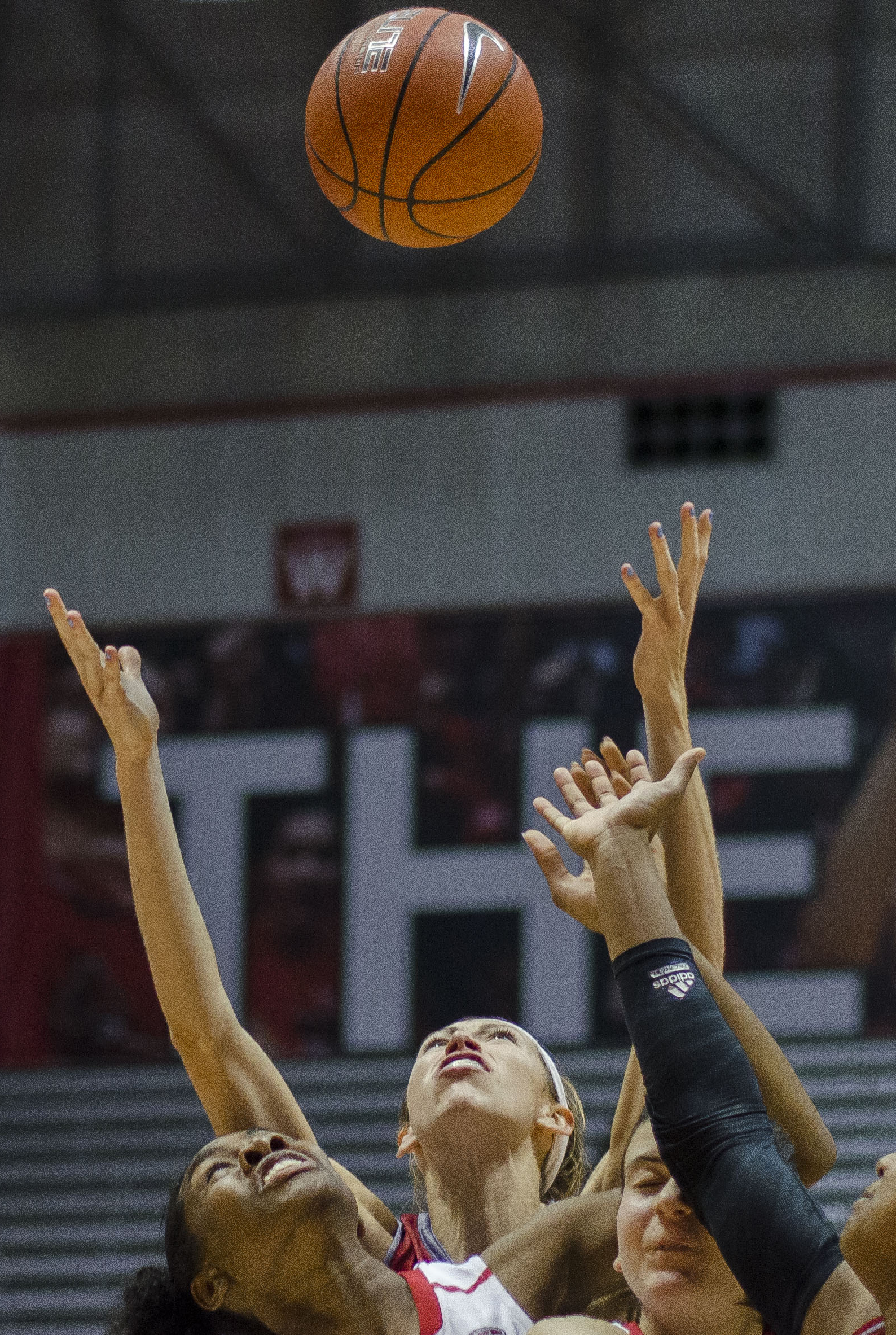 Members of the Ball State women's basketball game reach for a rebound in the game against Miami on Jan. 9, 2016, at Worthen Arena. Ball State won 66-41.