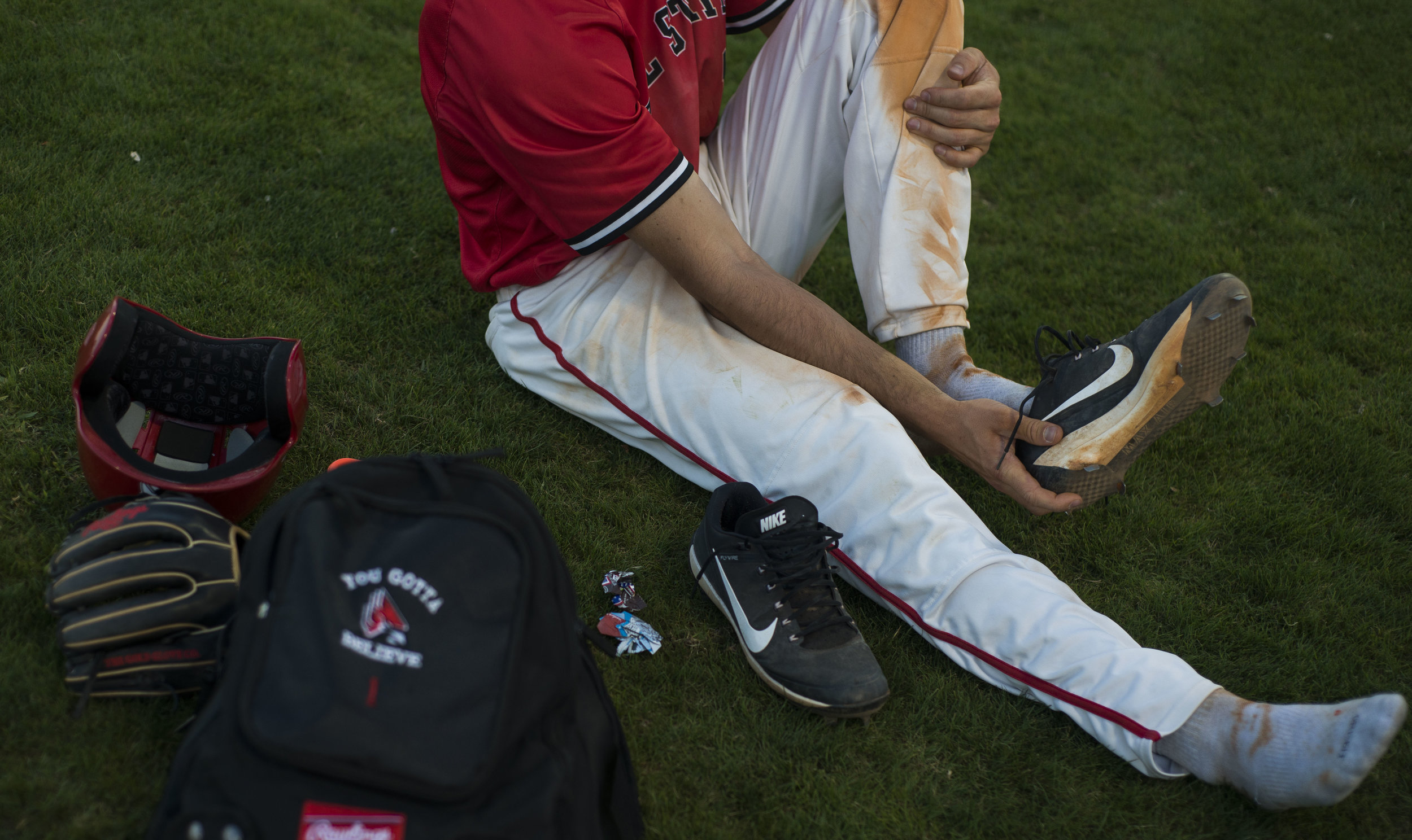 Junior infielder Seth Freed removes his cleats after the game against Chicago State on March 4 at North Charlotte Park in Port Charlotte, Florida. Ball State won the competition 8-6.