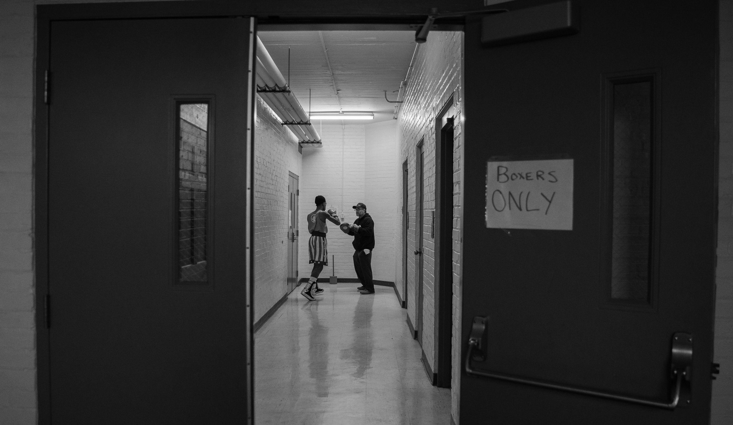 Spikes and Douthitt practice in an empty hallway before the Indiana Golden Gloves. Because of the small number of people in Spikes' weight class, he was given a bye for the first three weeks of the tournament. In his final fight, he fought Sergio Zambrano, to whom he had lost a match just two months prior.