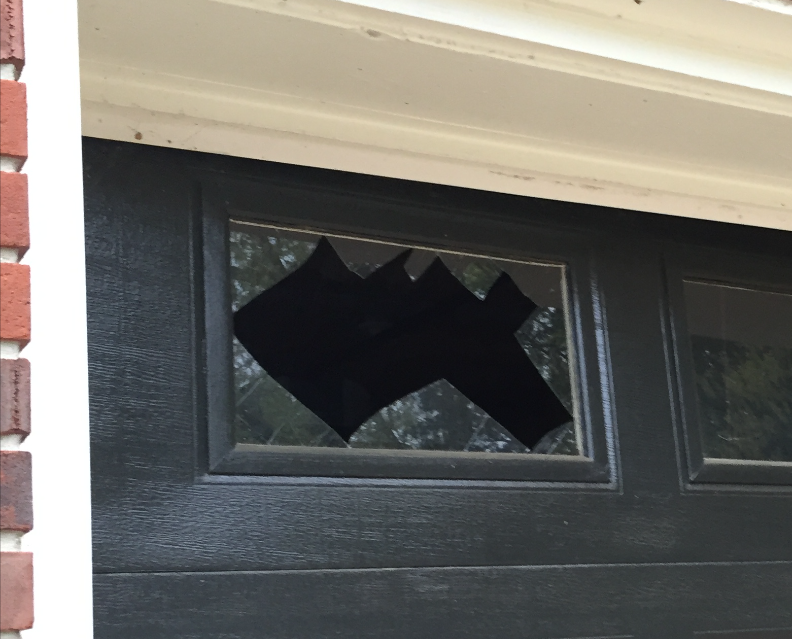 One piece of glass and the entire top panel was broken on our garage door.