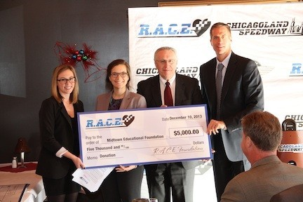 Pictured from left: Nicole Meagher, Director of Communications at the Chicagoland Speedway, Chelsea Davis and Bob Kornecki of Midtown Educational Foundation, and Scott Paddock, President, Chicagoland Speedway.