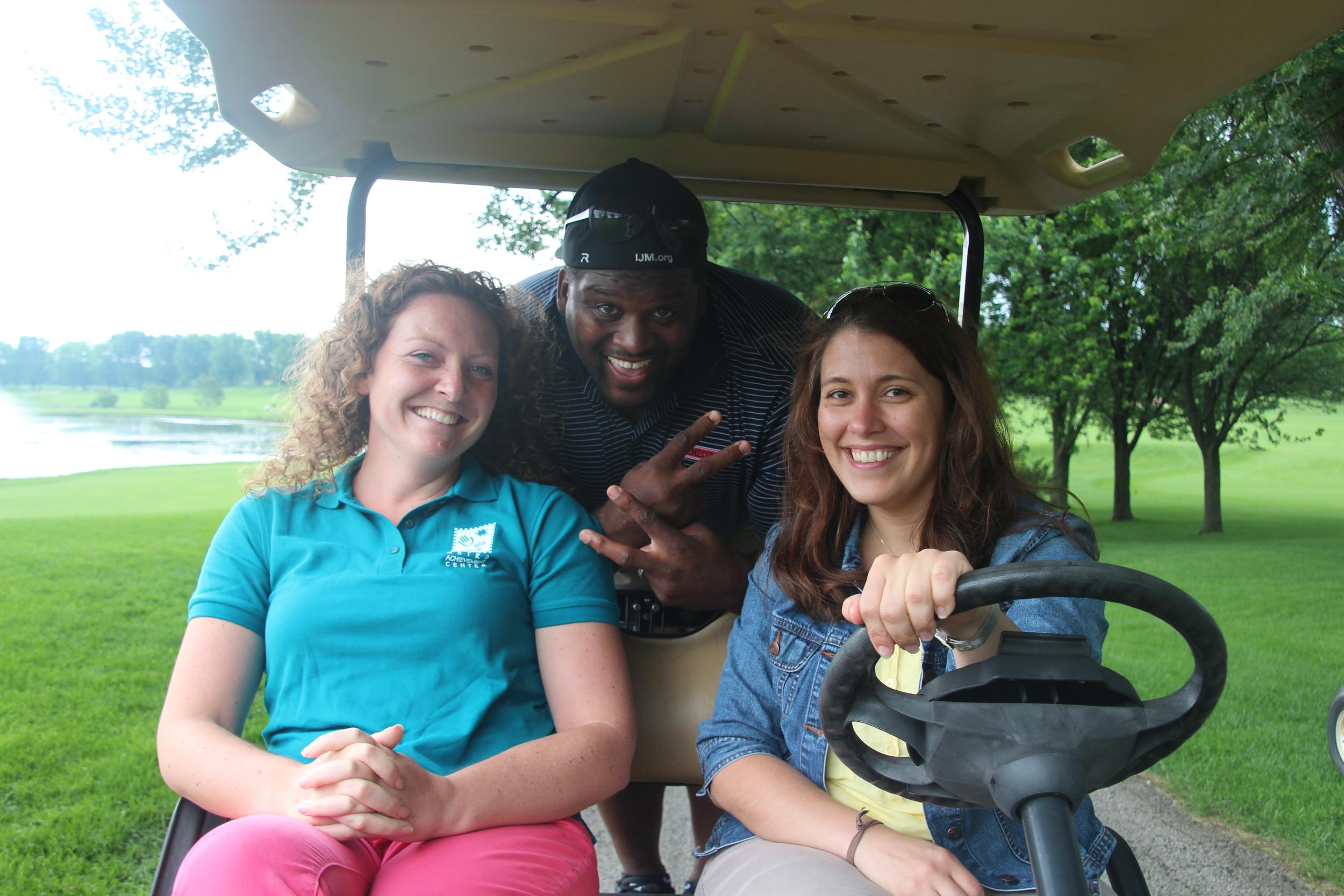 Anthony Adams,Center Director Erin Aldrich & volunteer Kara Mone.
