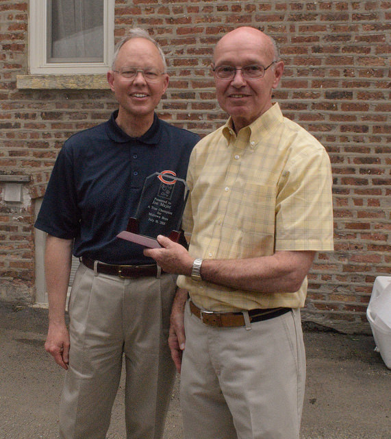 Joe Major receives an award as the first full-time employee of Midtown Center.