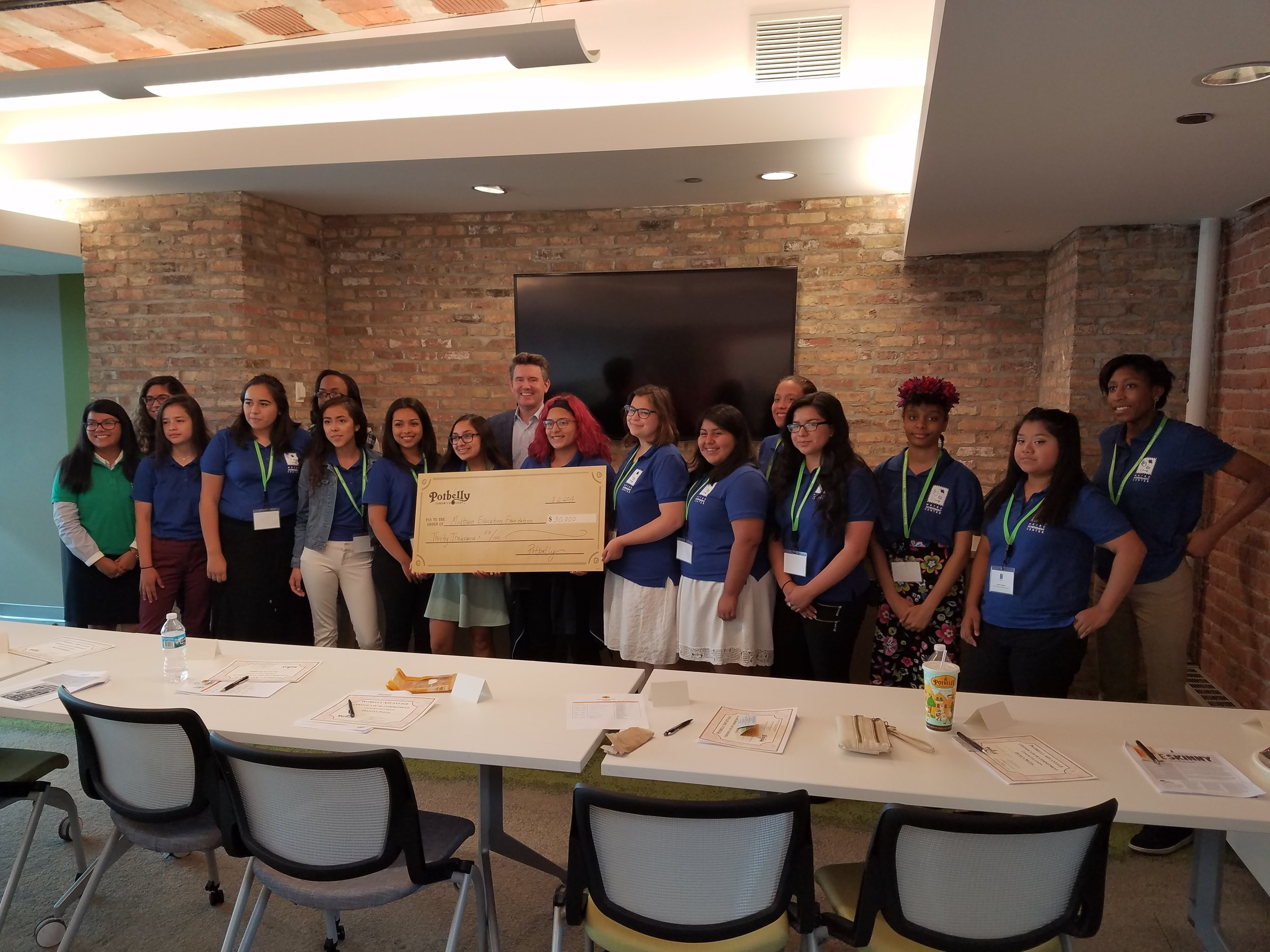 """Smiles abound as Mr. Coyne presented the sponsorship check. One of the girls asked him """"how to cash it."""""""