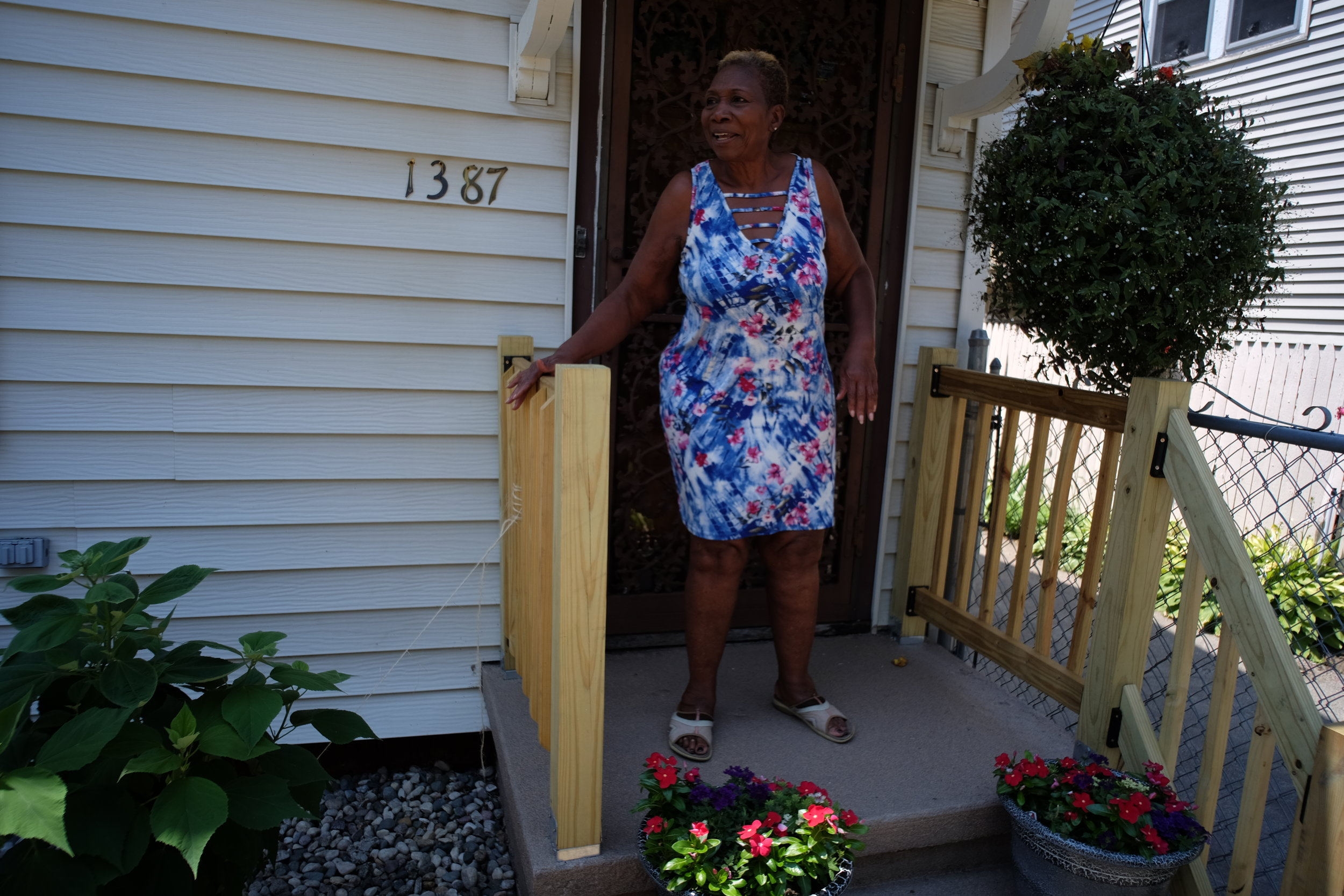 Ms. Craig on her new porch