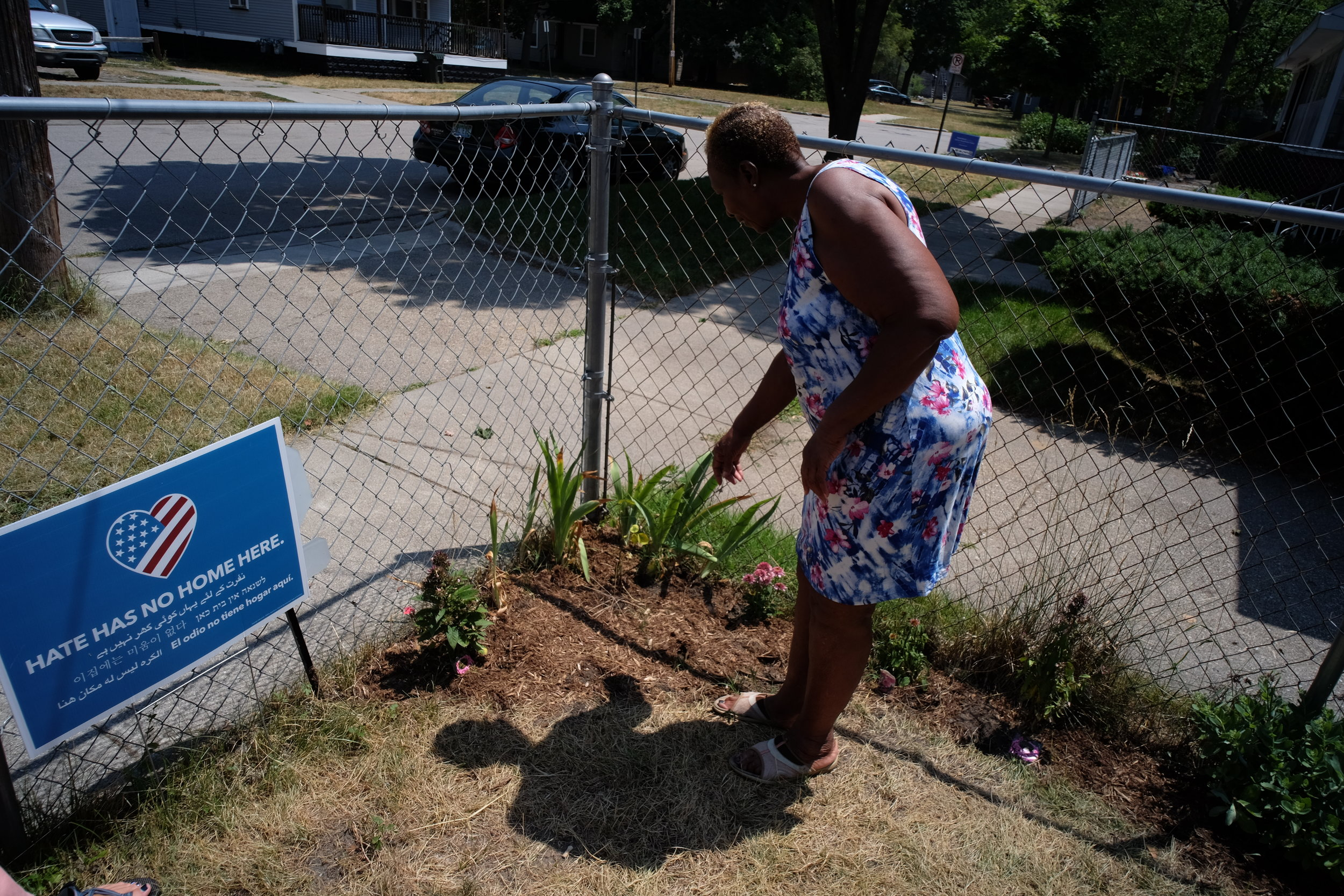 Volunteers transplanted a rose bush for Ms.Craig