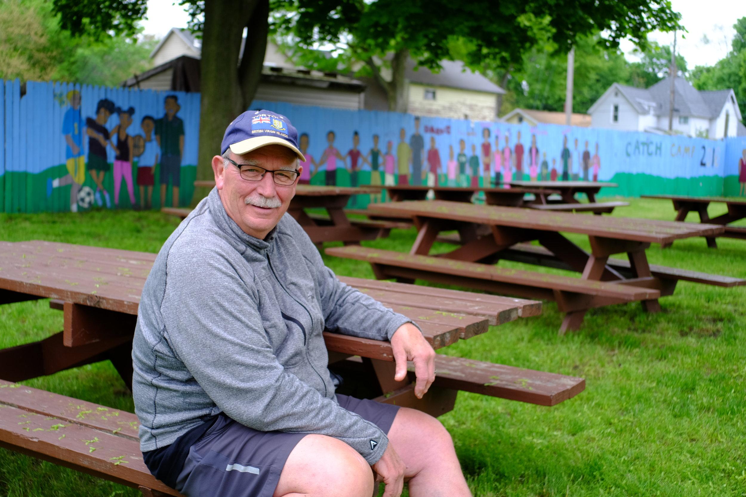 Tom sitting in McLaughlin Park opposite his home on Terrace St.